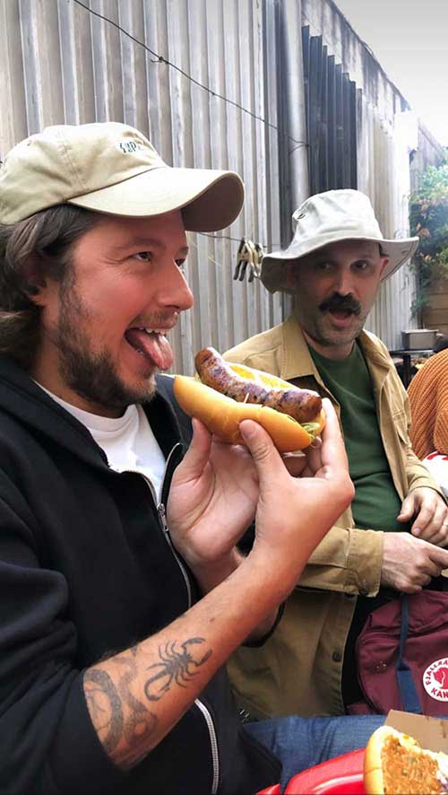 Anthony Falco enjoying a hot dog.
