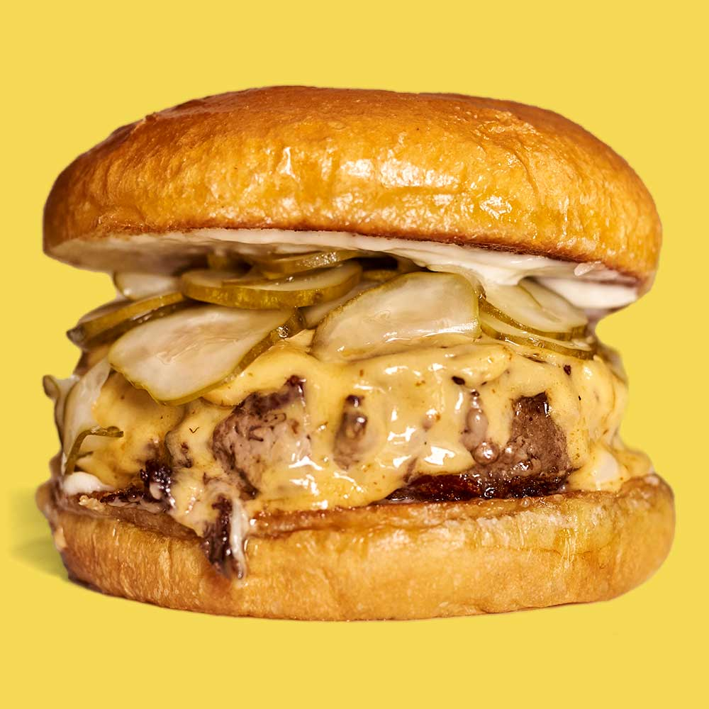 A Richard Eaglespoon burger with a yellow background.
