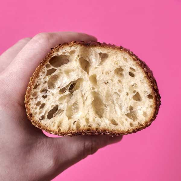 A seeded hoagie roll from this recipe with mortadella, sharp provolone, red onion, shrettuce, dijonaise, and pickled hot banana peppers.