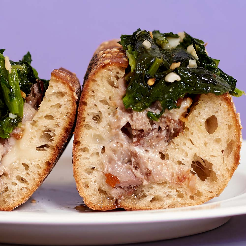 Pork confit, sharp provolone, and broccoli rabe on a seeded hoagie roll. You can also skip the scoop, because, really, the bread is the best part.