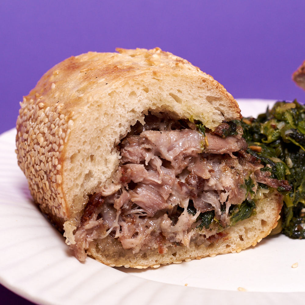 Pork confit, sharp provolone, and broccoli rabe on a seeded hoagie roll. Just like Wawa, you can scoop your hoagie rolls, too.