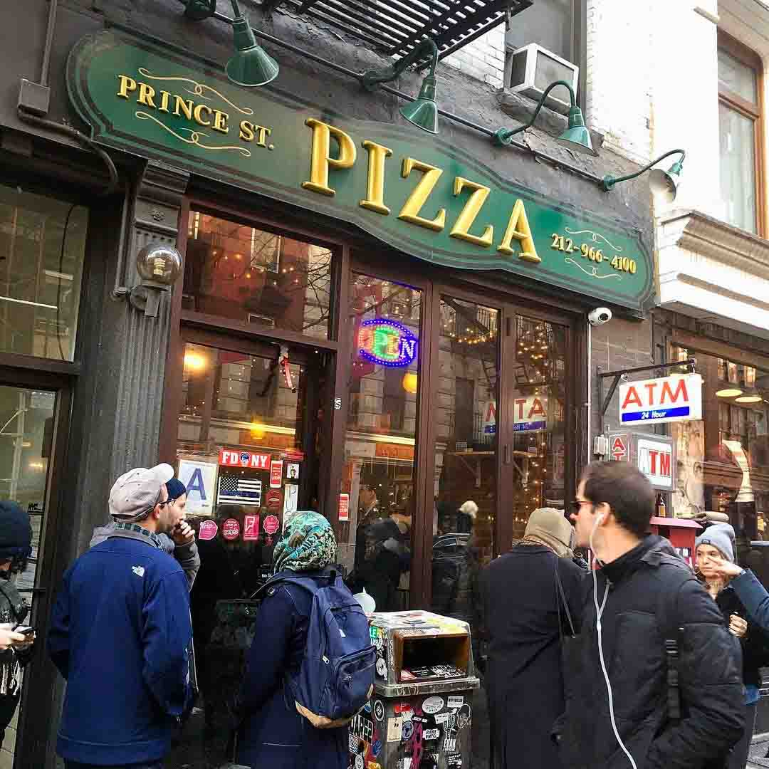 Photo of Prince Street Pizza store front posted on Instagram, featuring a Thin Blue Line flag sign on the pizzeria's front door. December 3, 2019